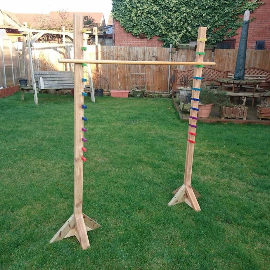 DIY wooden limbo setup in the yard