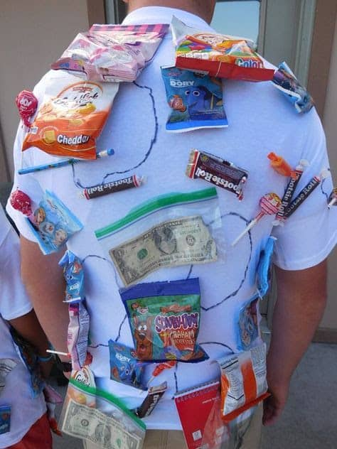 A man playing human pinata while wearing a shirt with prizes on it