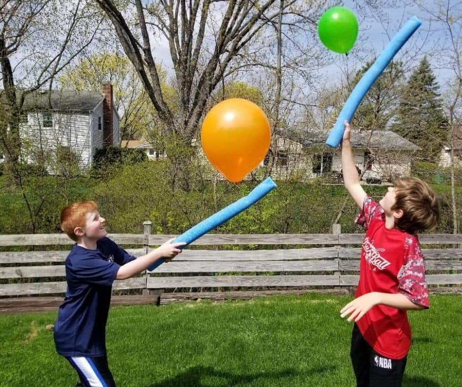 Children trying to keep up the balloon into the air
