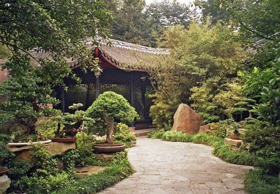 A garden with a Chinese-style pavilion