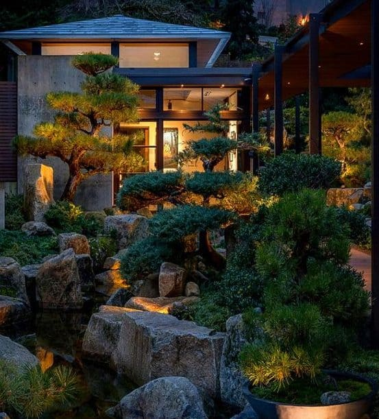 Narrow Chinese backyard with plenty of neatly trimmed trees and rocks