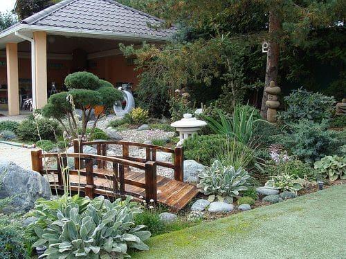 Oriental garden with a wooden bridge