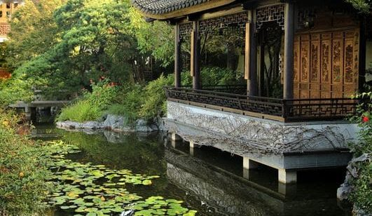A backyard river with a Chinese inspired architecture and deck