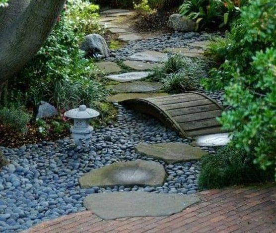 Black pebble river with some decorative bridges