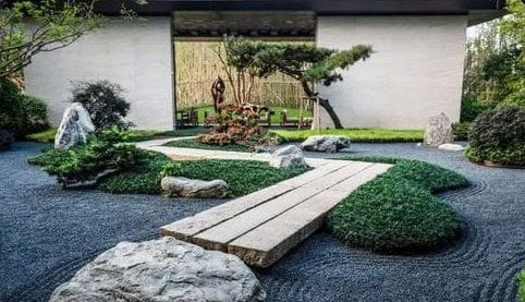 Wooden deck over black gravel