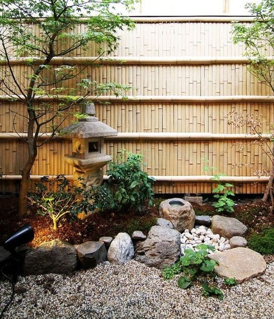 Bamboo and gravel giving off an oriental look and a great backdrop for a Chinese garden