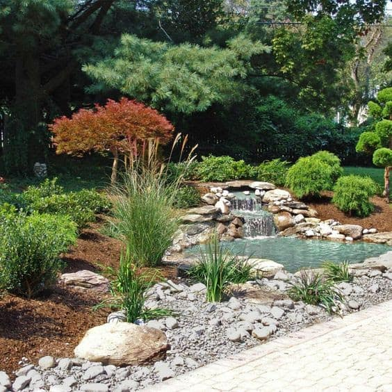 Pond and small waterfall as the focal point in this Chinese garden
