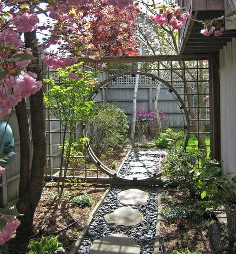 Moon shaped gate and stone garden path