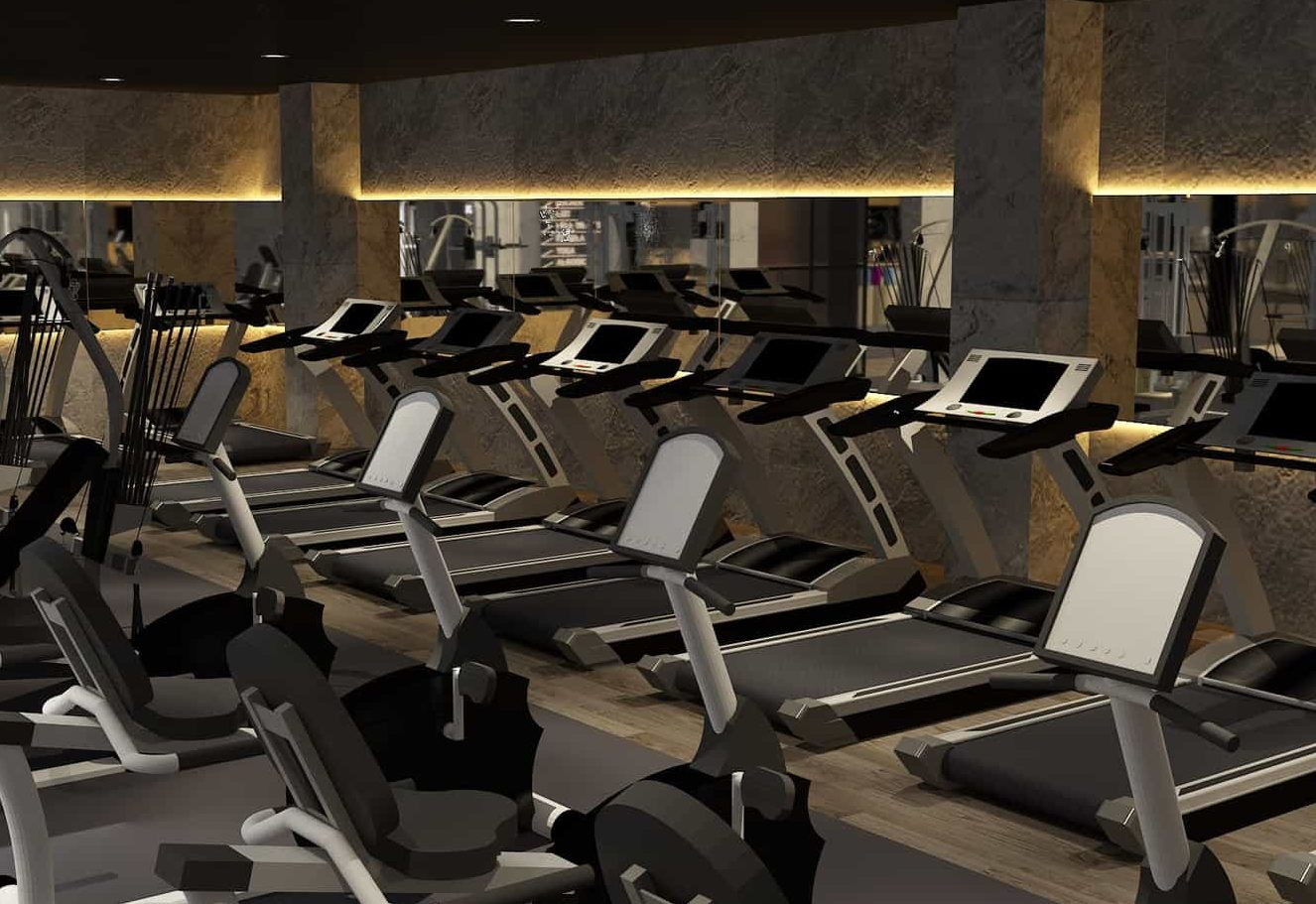 A gym with black interior and LED lighting