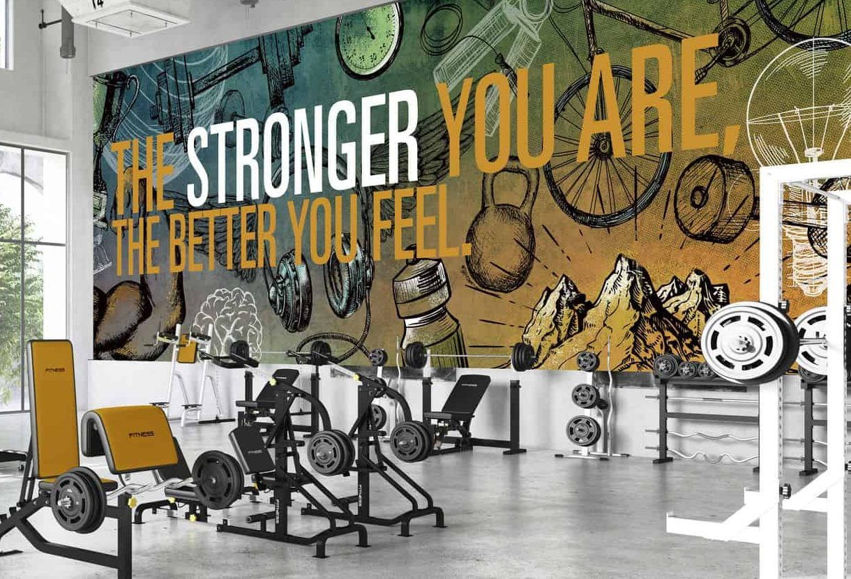 A certain wall in a gym with wall graphics and murals for extra inspiration
