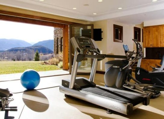 Open gym room with a scenic landscape of nature