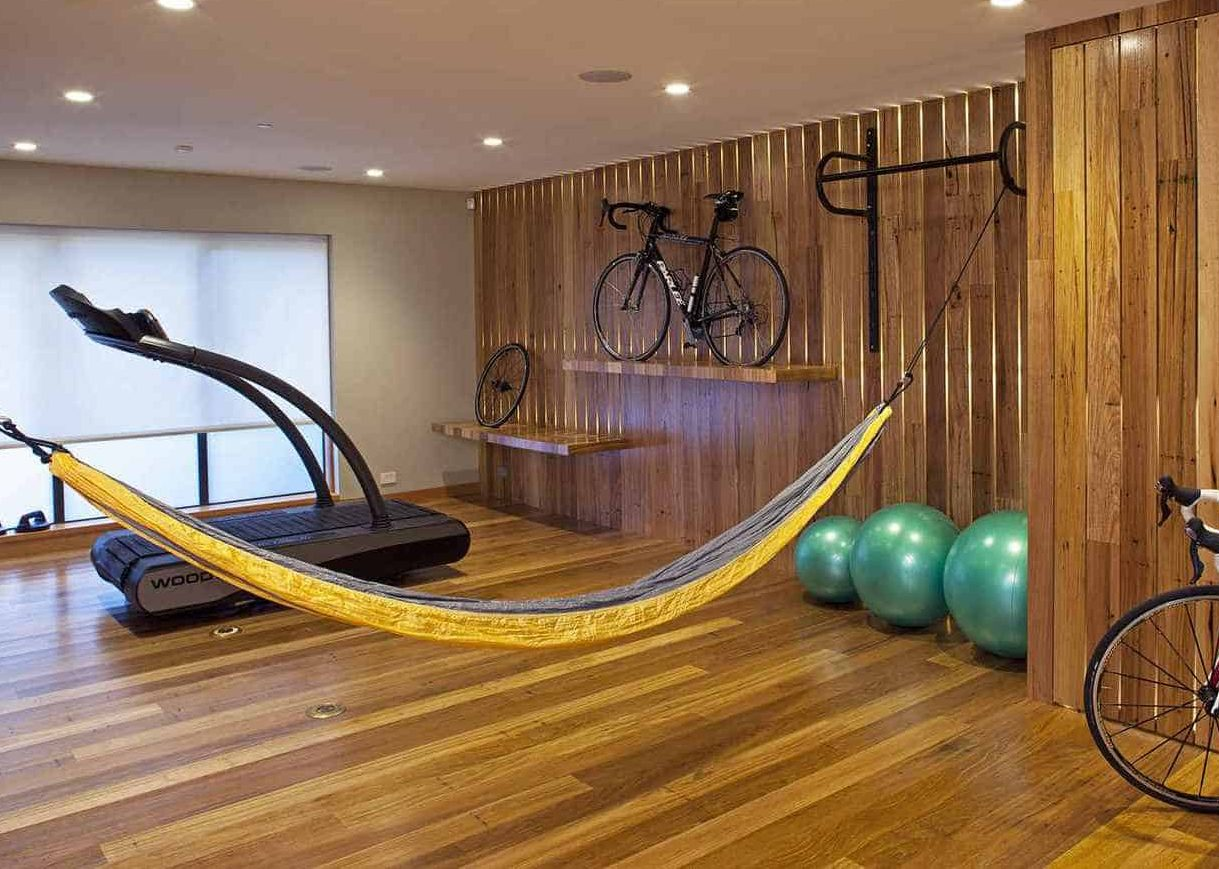 Wooden floor and accents to adding warmth to the overall garden gym interior