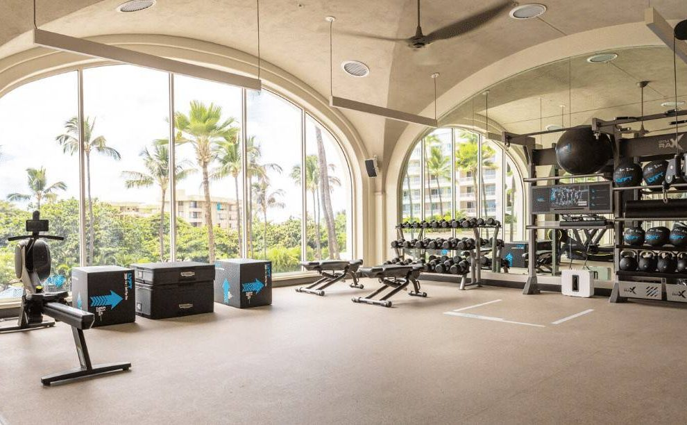 A luxury inspired fitness centre with large workout space and a beautiful view