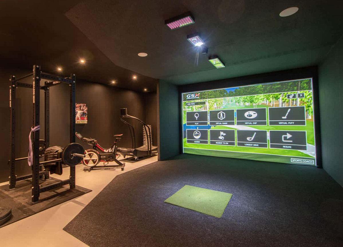 Modern gym room with a golf course simulator