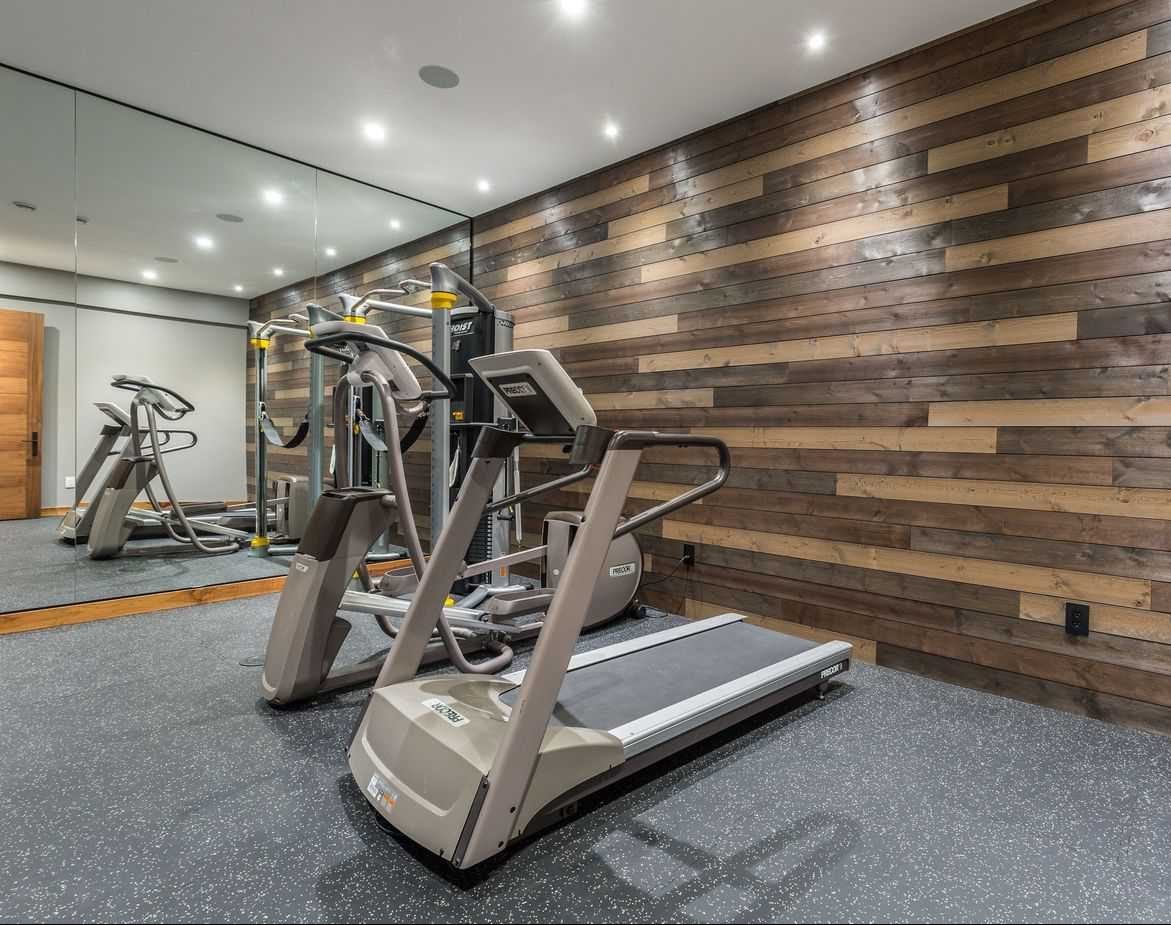 Wooden and bamboo wall accents in a modern gym setup