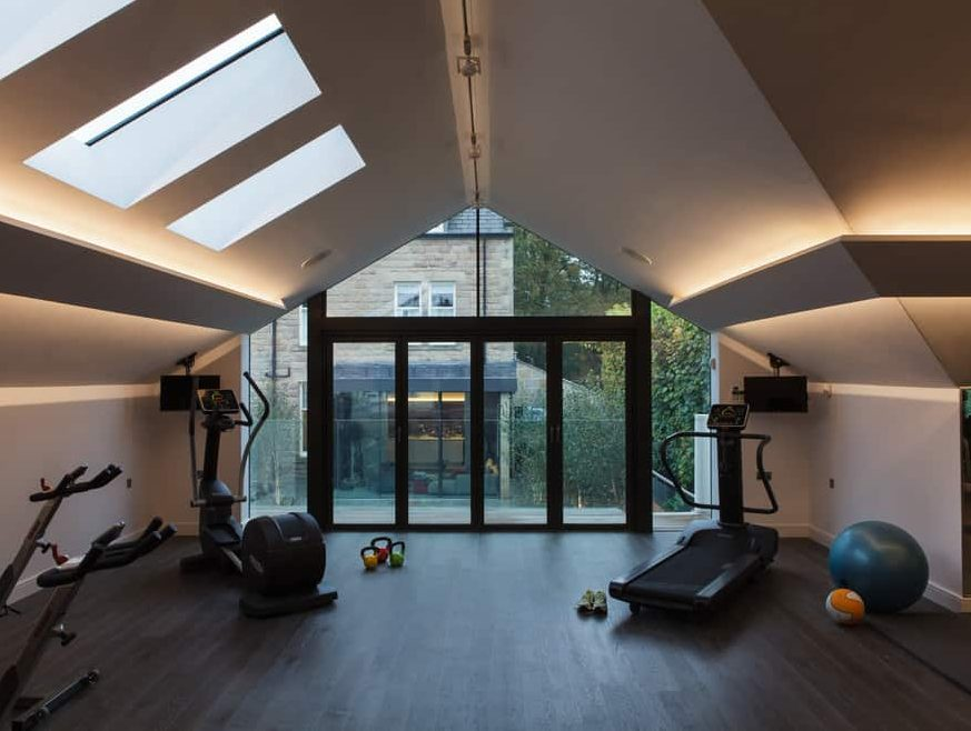 A home gym setup with LED lighting and strip lights