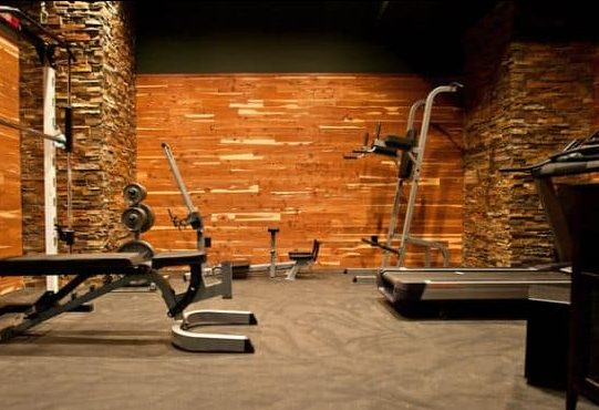 A simple garden gym decorated with coarse brick wall