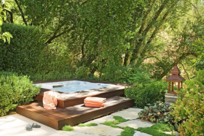 Garden spa set-up surrounded by greens and trees