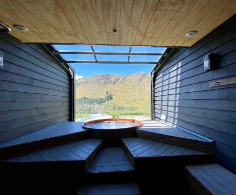 An open-space outdoor cabin hot tub