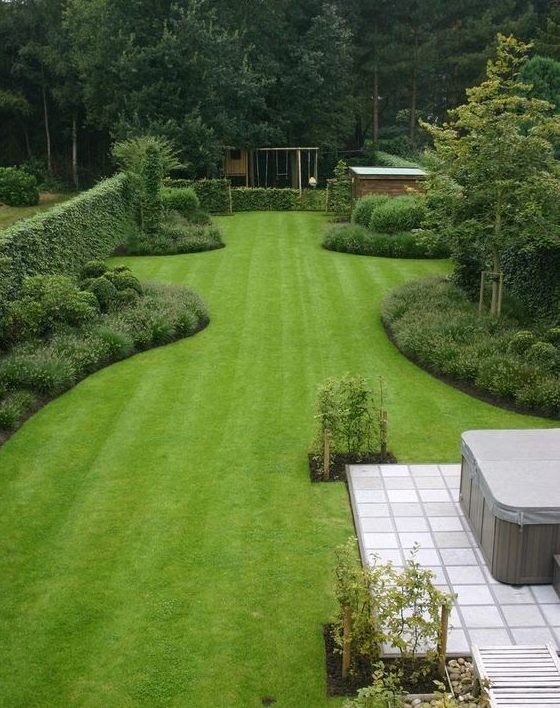 A simple, open garden filled with greens and trees
