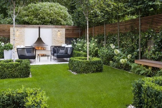 Modern garden with fireplace and luxurious, modern seating area