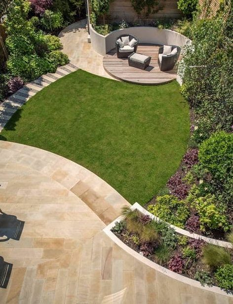 Two decks with curved shapes breaking up the large garden space