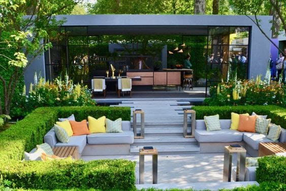 Sunken seating area and bar in a modern garden setting