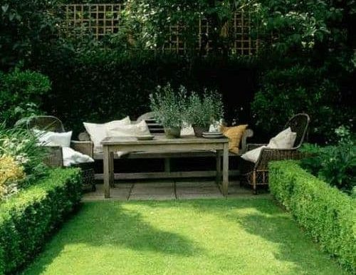 A traditional style sitting area with country kitchen table and simple chairs