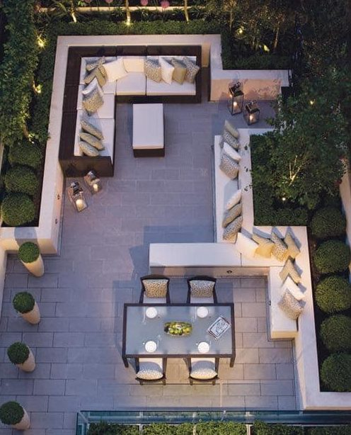 Raised flower beds and walls created a defined areas in the garden