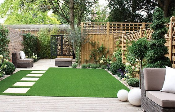 Artificial grass and stepping stones for a low-maintenance garden