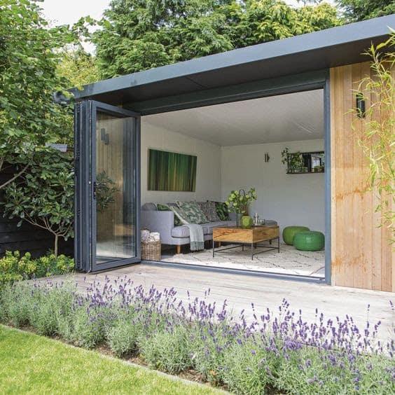 A mini log cabin as a garden living room