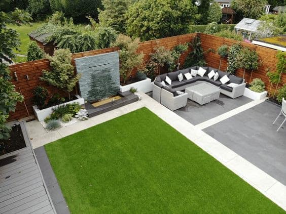 Corner spot with waterfall and grey outdoor seating set