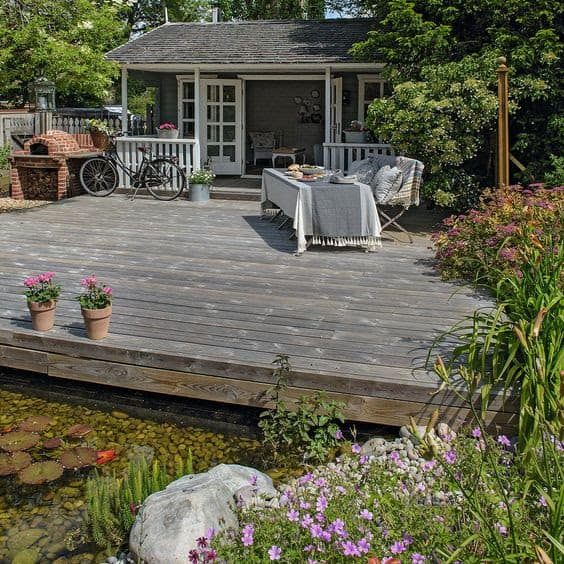 Huge rustic deck with a traditional house