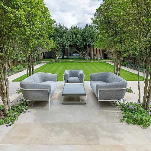 A symmetrical, open garden with simple trees and plants
