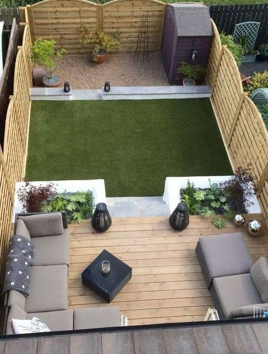 Deck, grass and shed with place for sitting and chatting