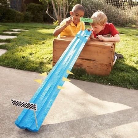 Two buddies playing backyard race track