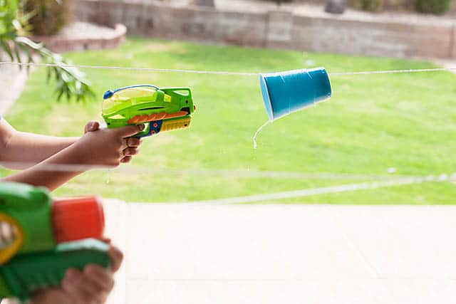 Water cup races with plastic cups and water guns