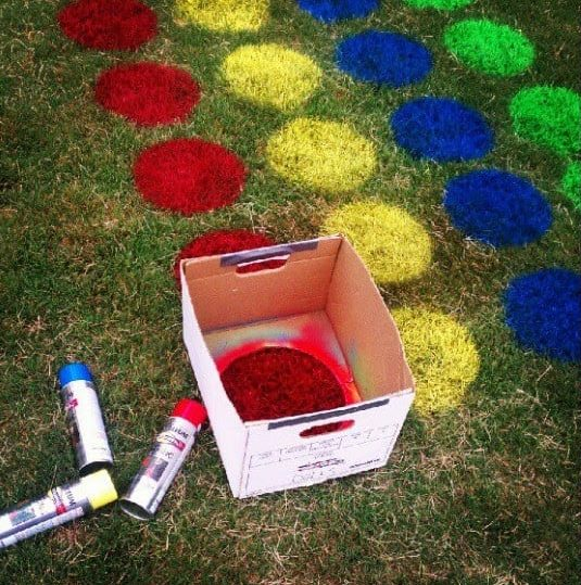 Garden twister game concept with painted lawns