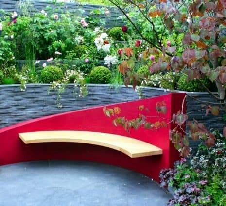Creative singular garden bench in red and yellow colours