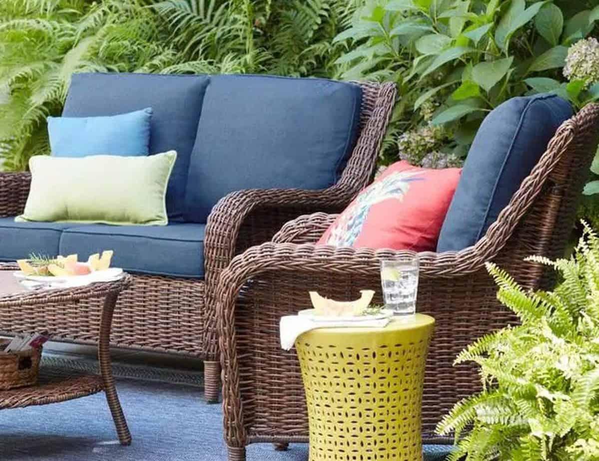 A basic synthetic rattan garden furniture in a simple garden space