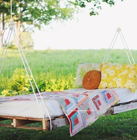 A garden hammock with DIY pallet frame