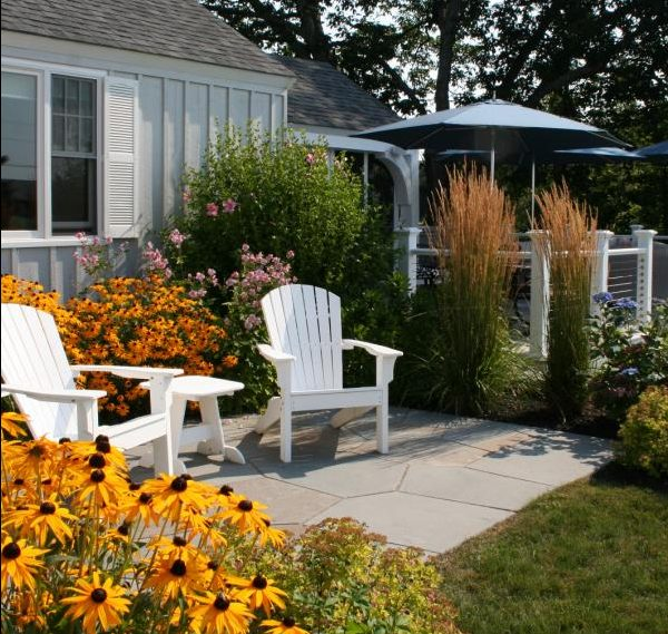 A pair of Adirondack chairs in white