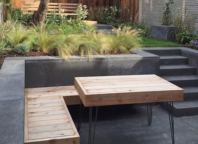 Tile clad patio with matching timber table and bench