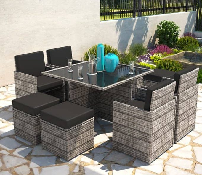 A rattan cube dining set on a small patio