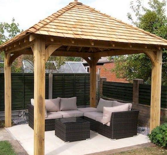 A garden gazebo with mini rattan furniture set