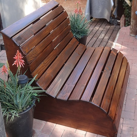 Slatted garden bench used as a garden love seat