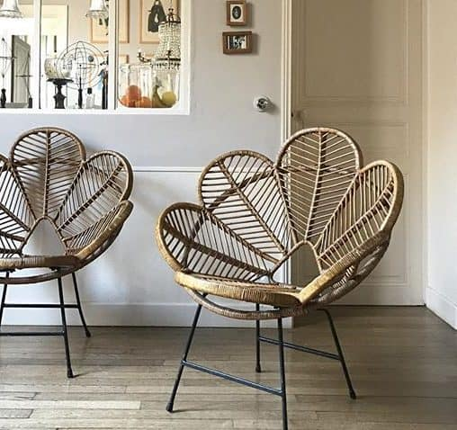 A pair of flower shaped wicker chairs