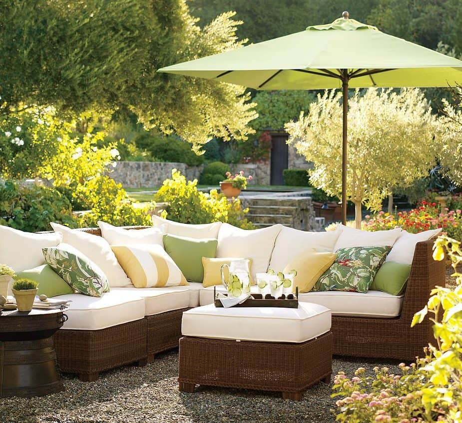 An L-shaped couch with stylish parasol for shade and privacy