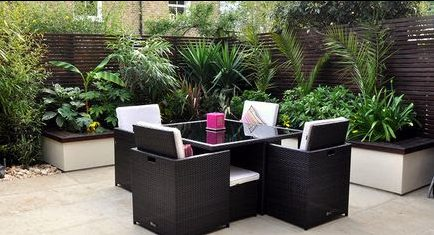 Modern urban jungle garden with synthetic rattan outdoor dining set