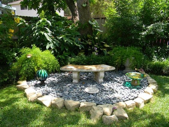 Rock resting spot with exotic plants